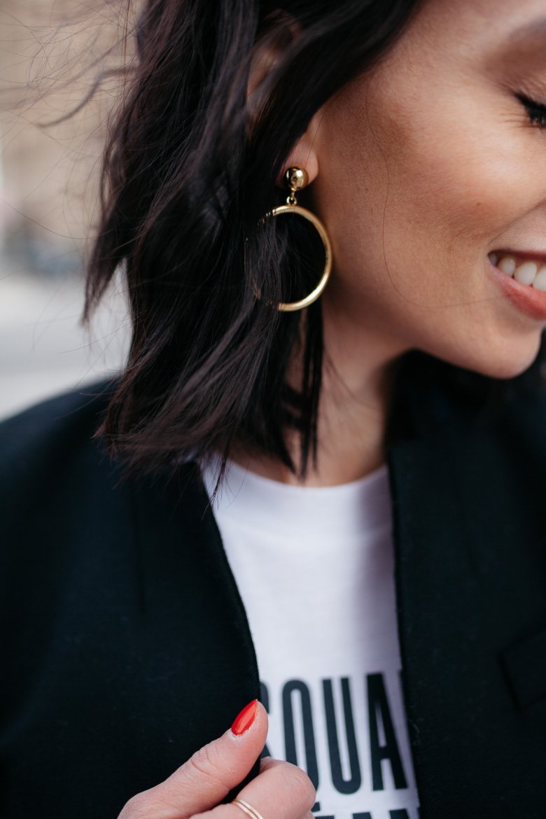 Top US fashion blogger, Wellesley & King, styles a graphic tshirt three ways: girl in tshirt, jcrew blazer, and gold hoop earrings