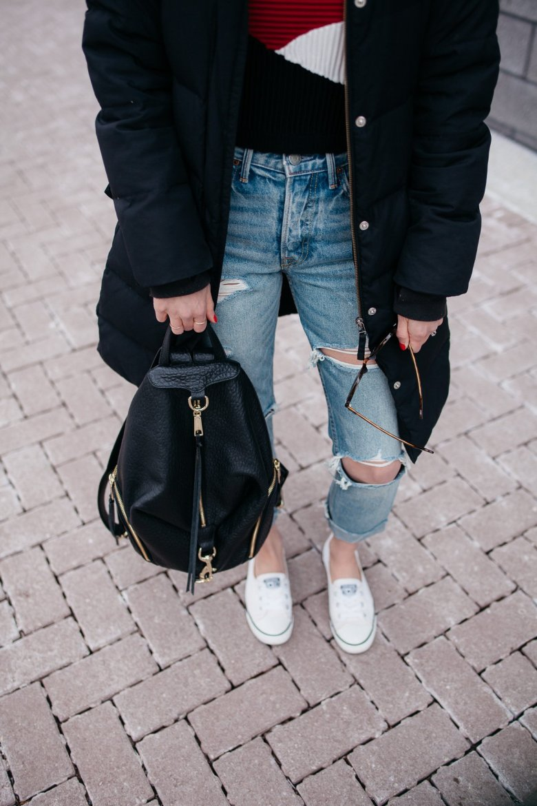 Top US fashion blogger, Wellesley & King, styles a crop sweater and distressed jeans for a chic casual outfit: distressed jeans with converse sneakers and chic leather backpack