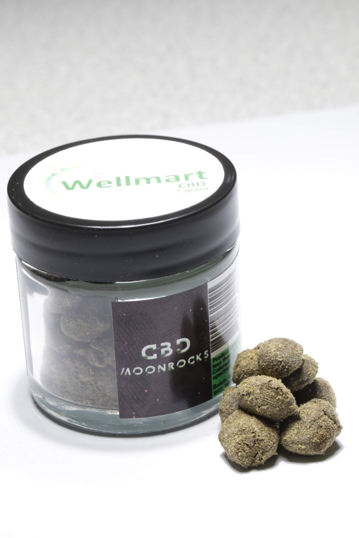 cbd moon rocks next to a WellmartCBD jar
