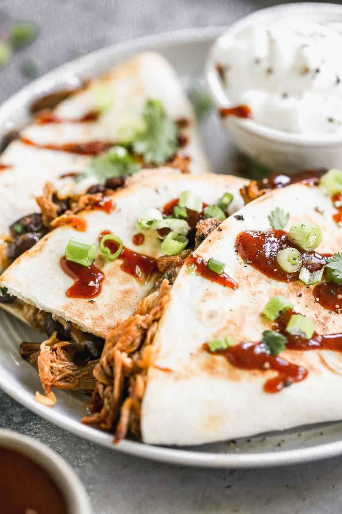 pulled pork quesadillas on a plate