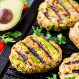 Chicken Avocado Burger – diced fresh avocado mixed with ground chicken or turkey, cilantro, and Tex-Mex spices, topped with chipotle yogurt sauce. Easy, healthy and ready in 30 minutes! Our favorite chicken burger recipe. Recipe at wellplated.com   @wellplated