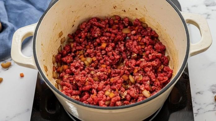 Hamburger helper ingredients in a pot