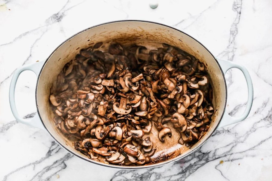 Cooked mushrooms in a Dutch oven