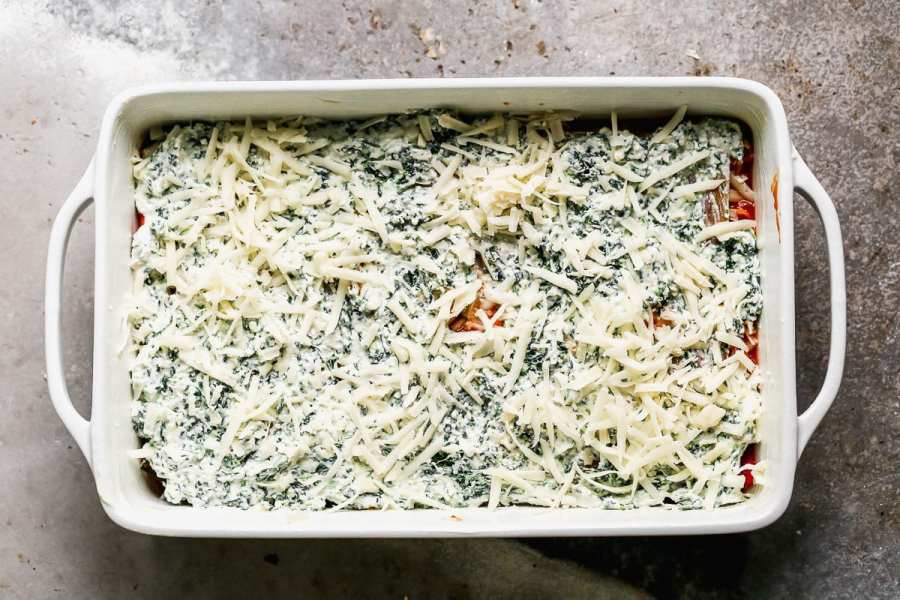 Healthy vegetable lasagna being made in a baking dish