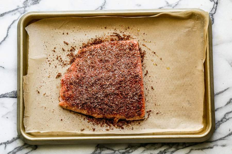 Salmon with spices on a baking sheet