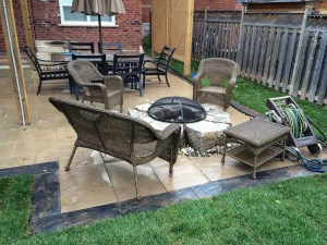 landscape-Oakville backyard with stone deck and fire pit