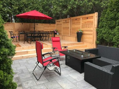 landscape-Oakville stone and wooden deck with fence