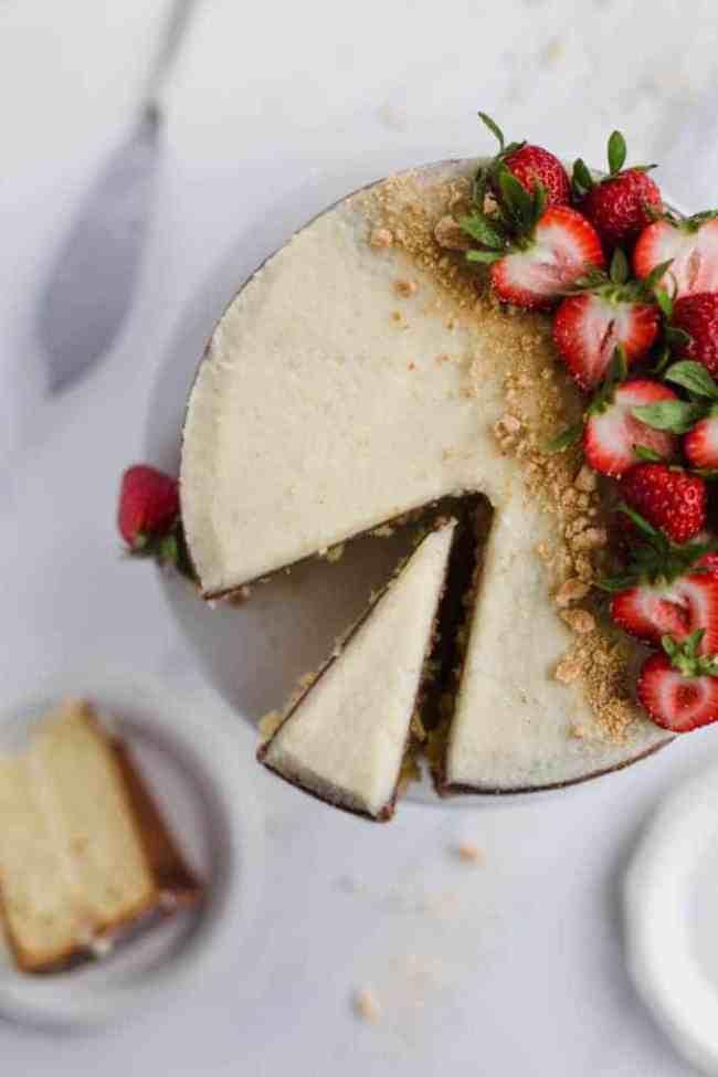 classic vanilla layer cake with mascarpone buttercream and fresh strawberries