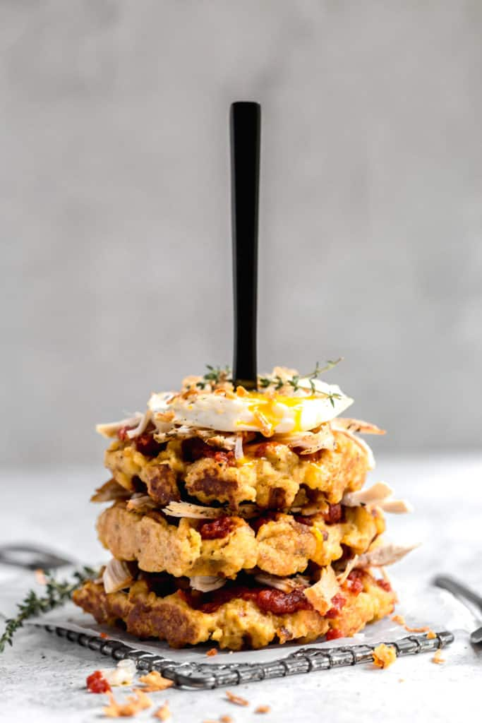 Cornbread Stuffing Waffles with Tomato Jam, Turkey, And Crispy Fried Onions
