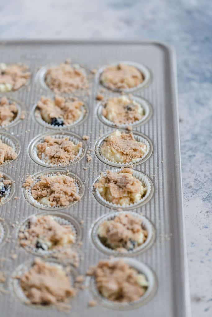 miniblueberry streusel muffins in muffin tin