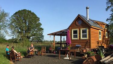 buy a tiny house on land