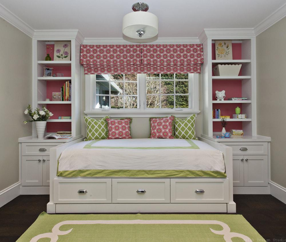 daybed with built-in shelves under window