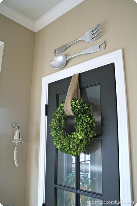 boxwood wreath over pantry drop
