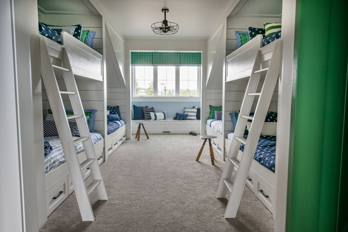 white navy and green bunk room with alcoves