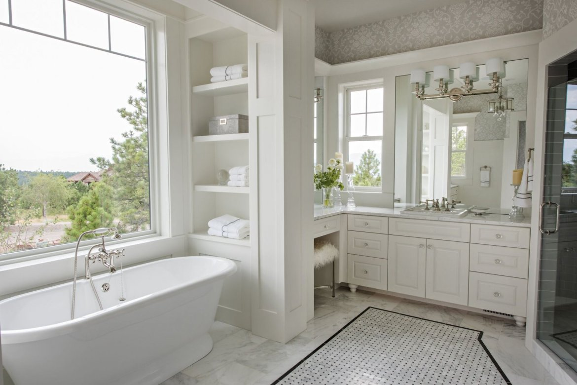 white bathroom with marble and built-in shelf parade of homes