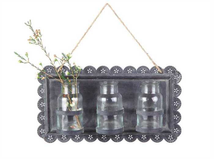 metal wall hanger with three glass vases