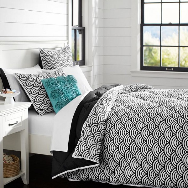 black and white and teal bedroom with shiplap