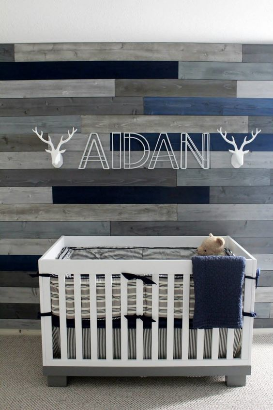 navy and gray nursery with reclaimed wood wall