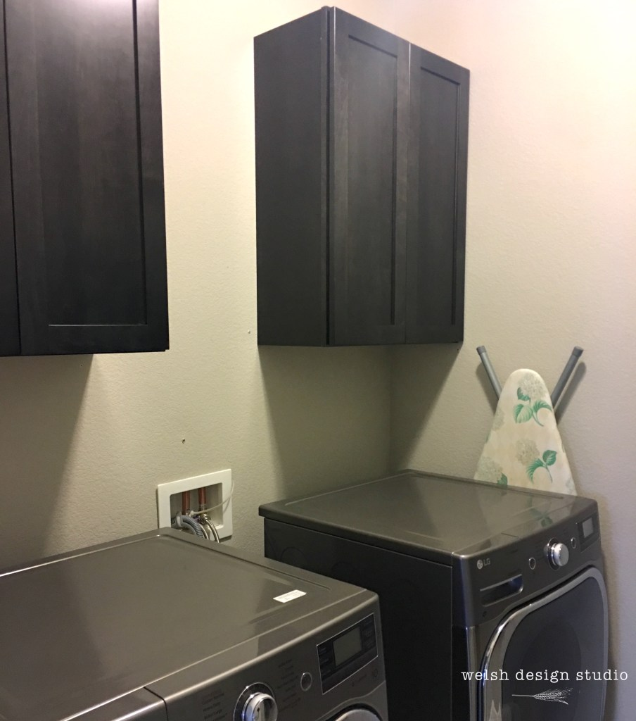 laundry room black cabinets