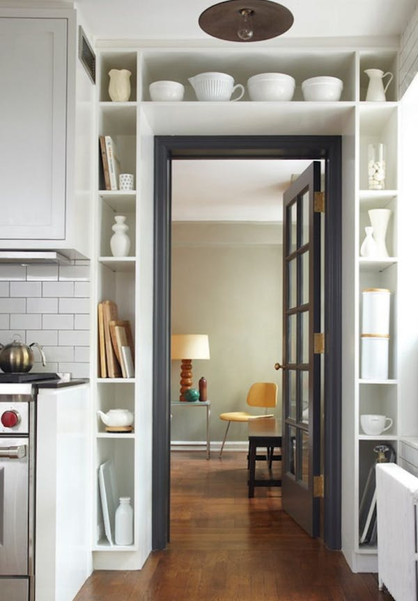 built-in shelving over doorway