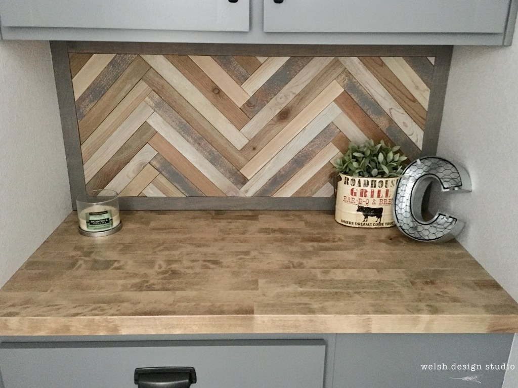 wood herringbone backsplash