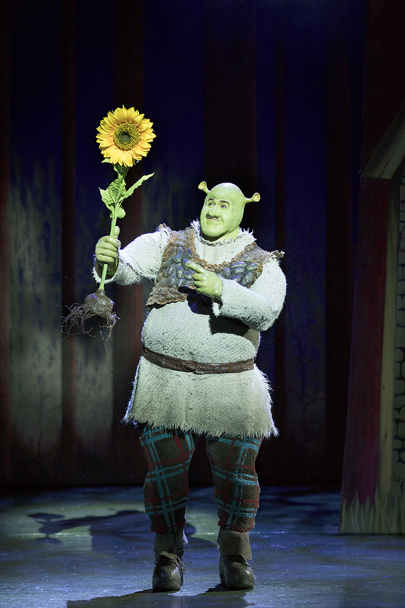 Steffan-Harri-as-Shrek.-Shrek-the-Musical.-Credit-Helen-Maybanks