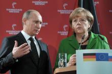 <br /><br /><br /><br /><br /> Er spricht Deutsch, sie Russisch: Als das Mikrofon ausfällt, übersetzt Putin die Frage eines Journalisten – doch Merkel bleibt auf Distanz<br /><br /><br /><br /><br />