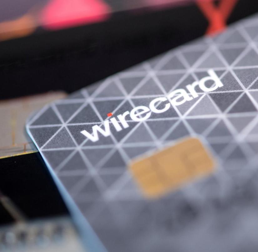 ARCHIVE - 08/23/2018, Bavaria, Aschheim: A credit card from payment service provider Wirecard is on a table in a company's showroom. On February 14, 2020 the company will present its annual figures. Photo: Sven Hoppe / dpa +++ dpa-Bildfunk +++ | Use worldwide