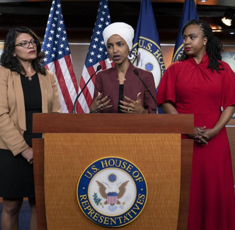 Congressmen (from left) Rashida Tlaib, Ilhan Omar, Ayanna Pressley, and Alexandria Ocasio-Cortez commenting on Trump's racist attacks against them