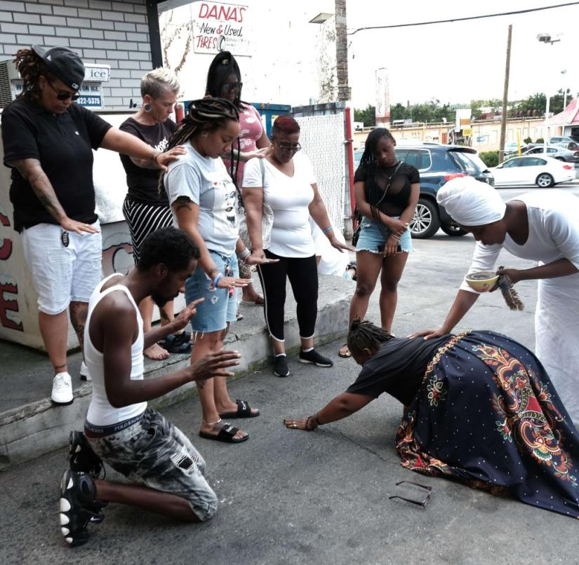 Remembering those killed: People at a gas station in Baltimore remember murder victims