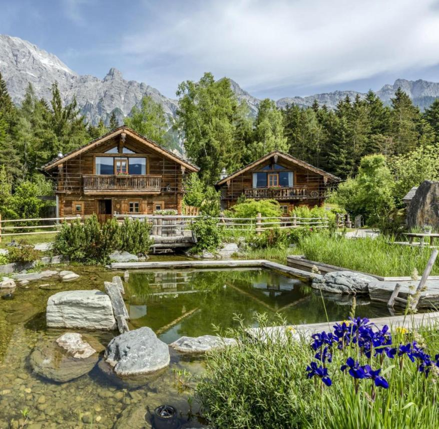 Salzburger Land (Austria): The mountain village of Priesteregg consists of 18 wooden chalets that are built around a square with a swimming pond and a jetty