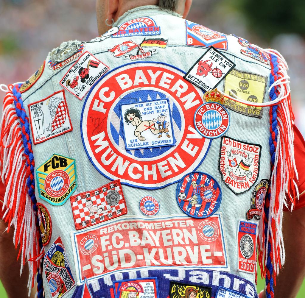 Football 1. Bundesliga: FC Bayern Muenchen fan with cowl