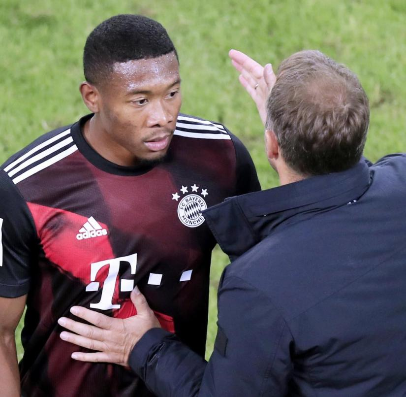 Bayern coach Hansi Flick (right) has to try to somehow keep Alaba happy