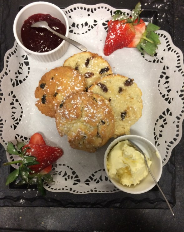 handmade scones with clotted cream and jam