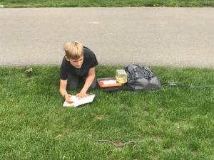 Torsten Watkins studying in the field