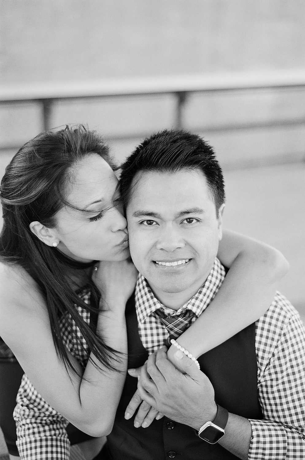black and white photos of engaged couple at High Line taken by nyc wedding photographer wendy g