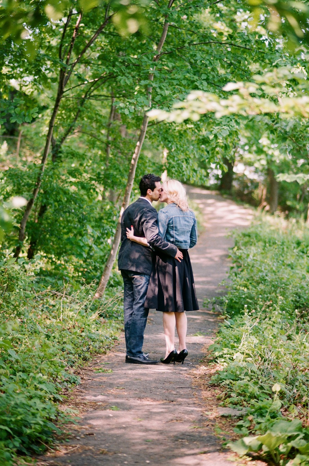 engagement portrait of couple walking in fort tryon park by wendy g photography