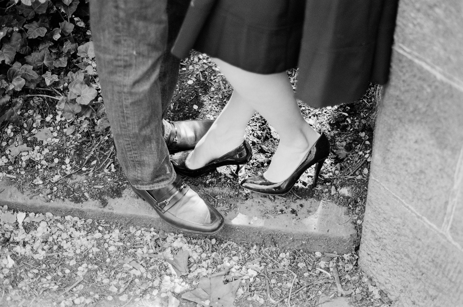 black and white photo of engaged couple shoes