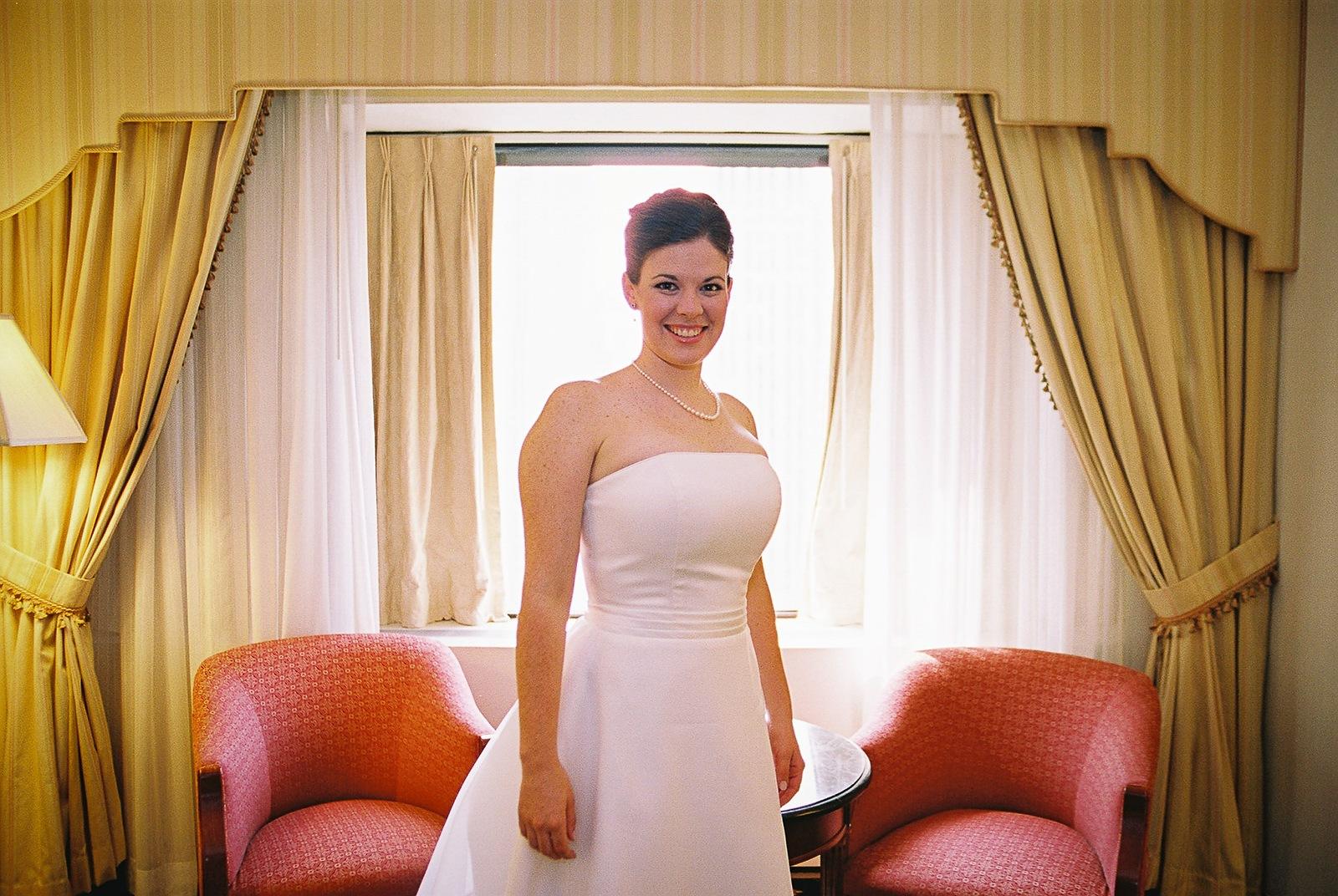 bride is posing in wedding gown before office ops wedding
