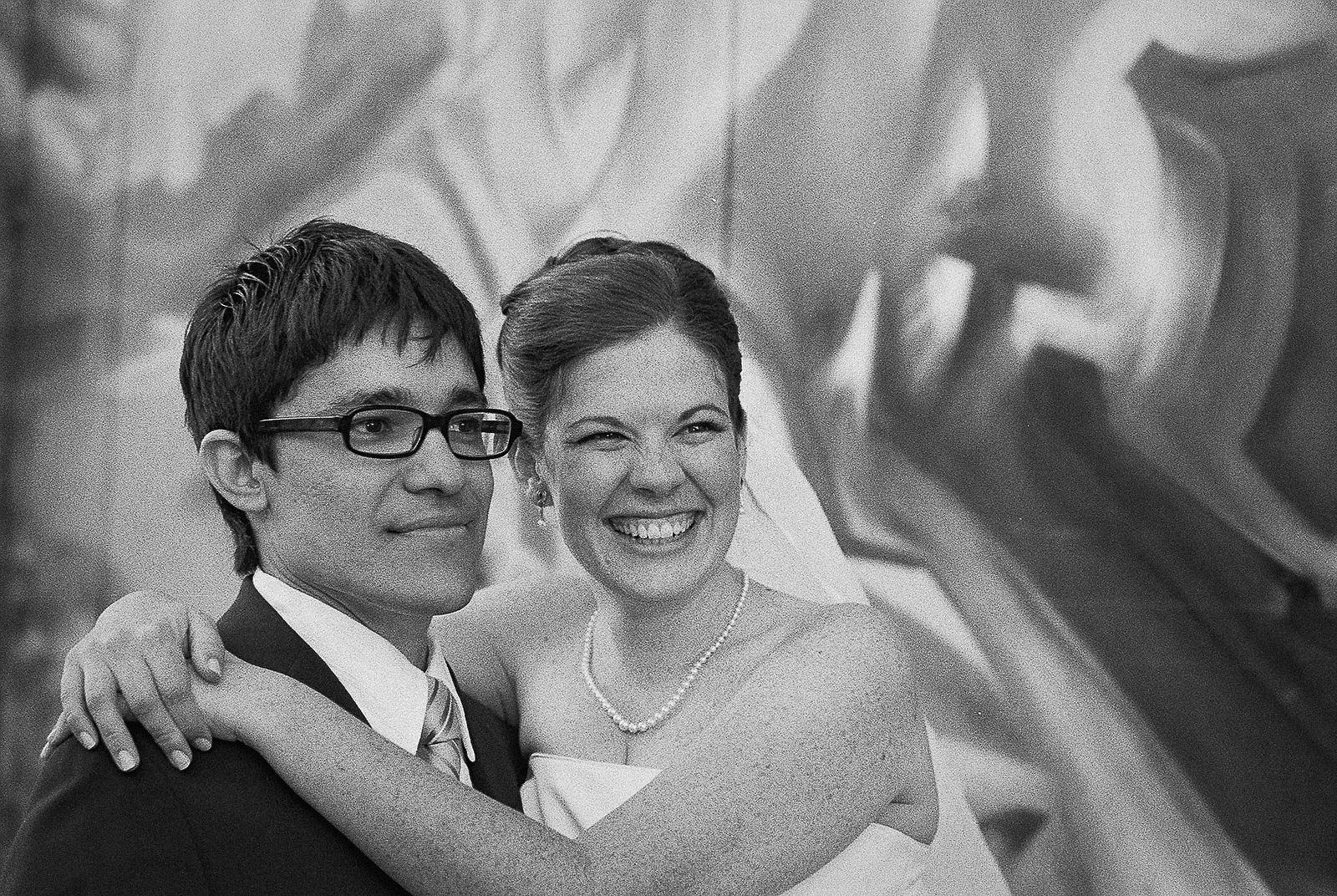 bnw bride and groom hugging graffiti