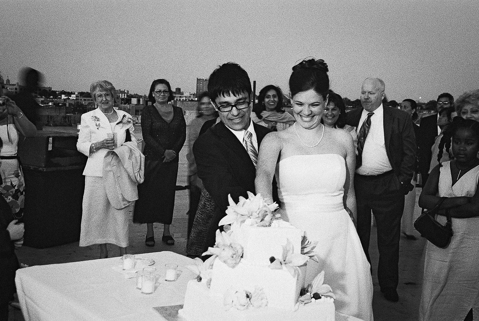 cutting wedding cake BNW brooklyn office ops