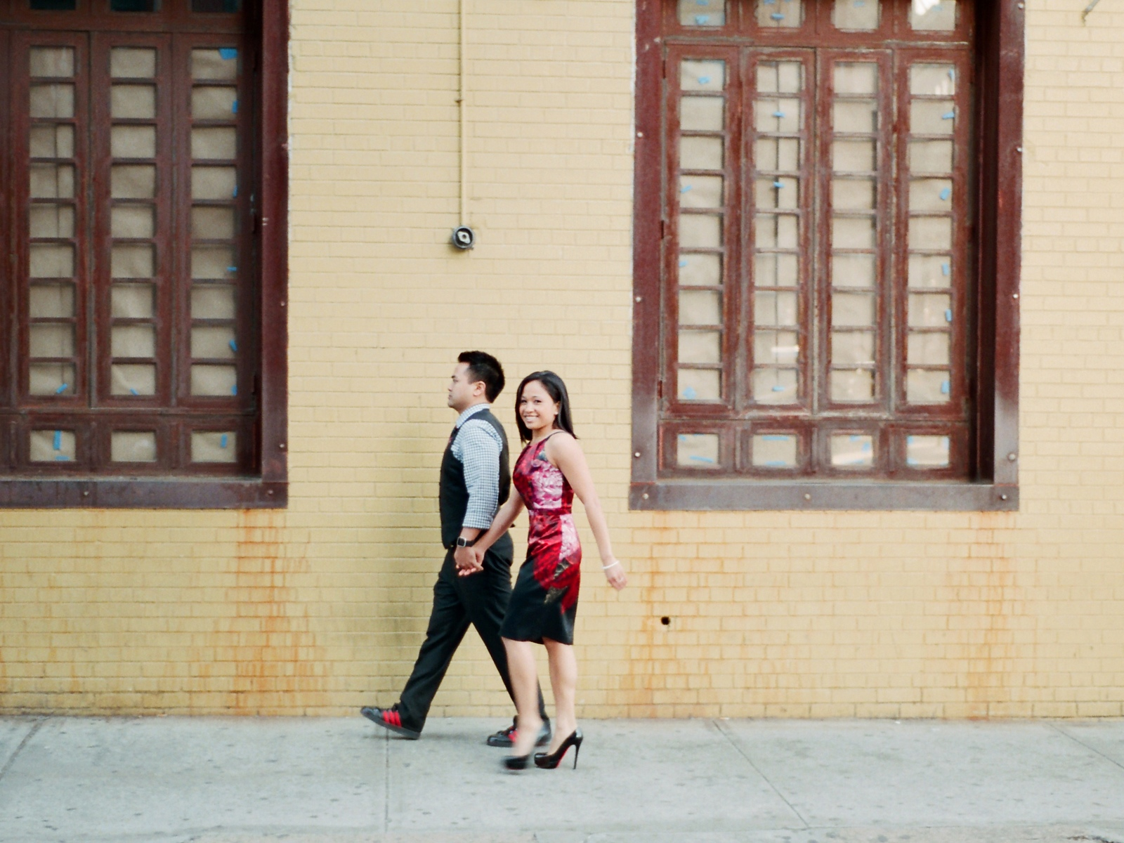 engaged couple walking holding hands in greenwich village
