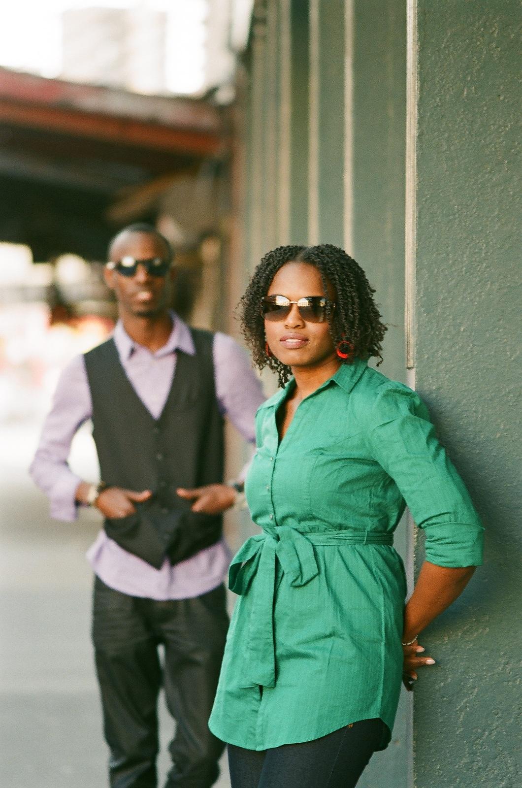 couple posing wearing sunglasses nyc