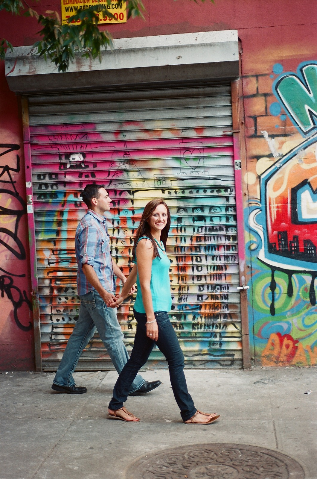 engagement photo in nyc couple walking holding hands bride smiling