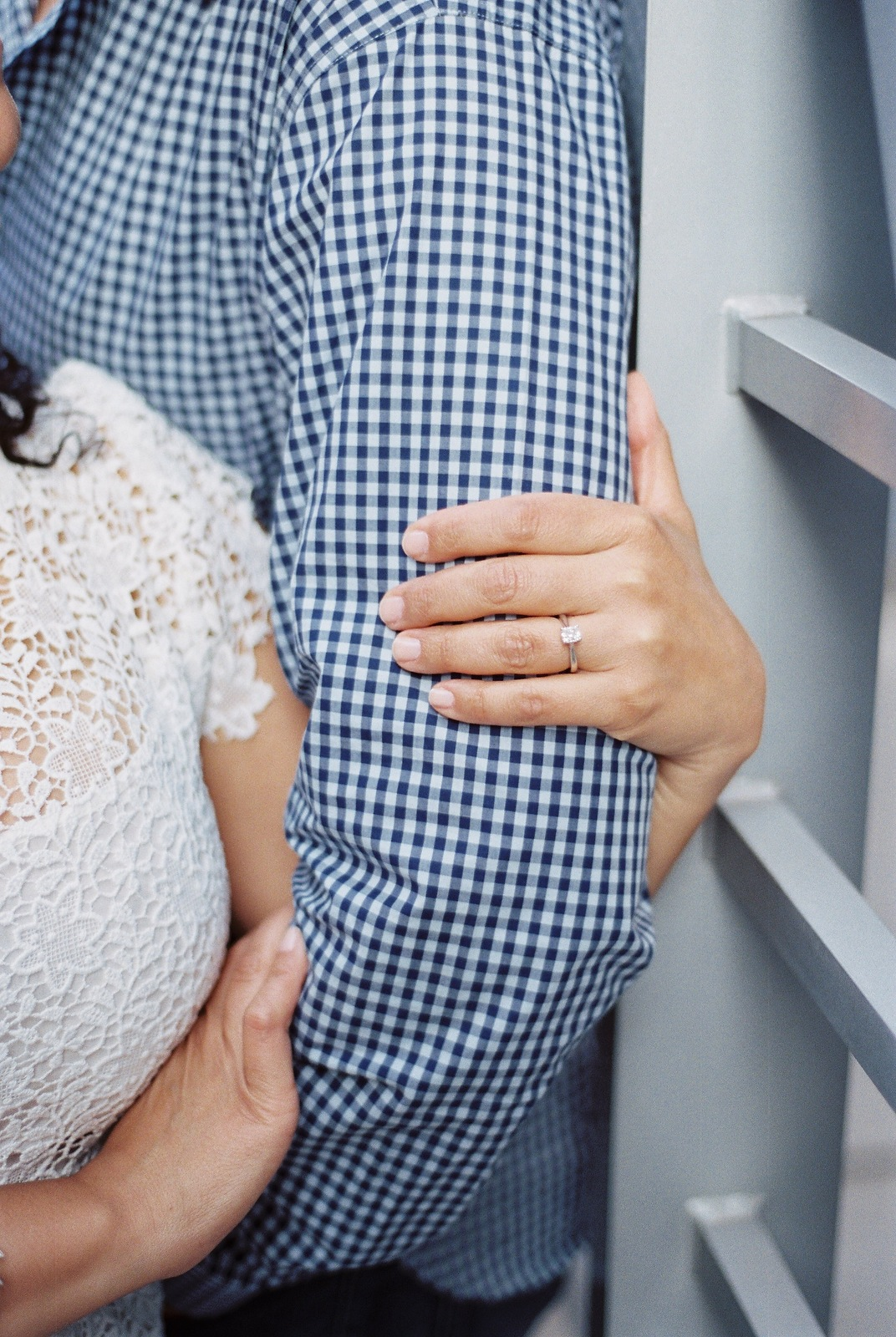 close up of engagement ring and bride holding groom's arm in nyc