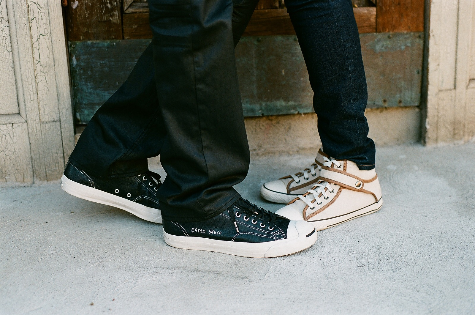engaged couple's feet wearing custom chuck taylor all stars
