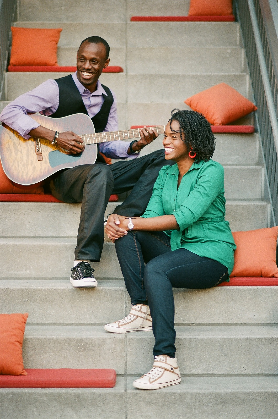 engagement portrait of couple playing guitar in meatpacking district