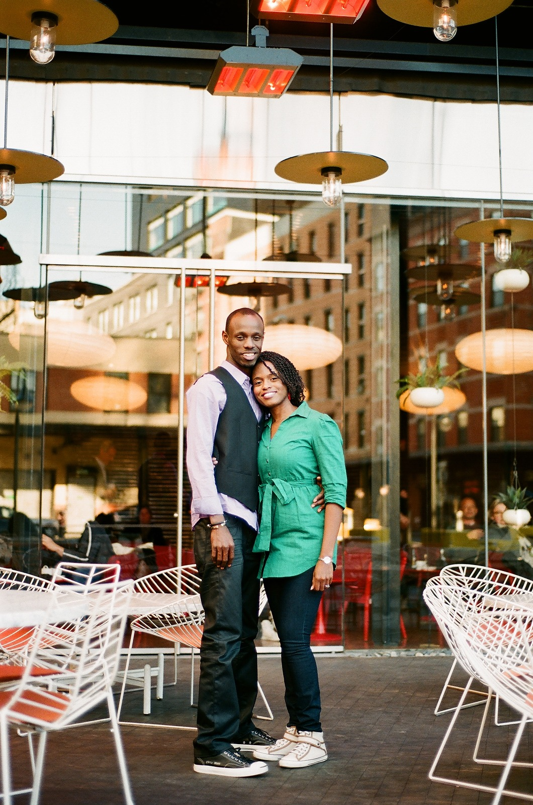 couple standing outside restaurant hugging in front of restaurant