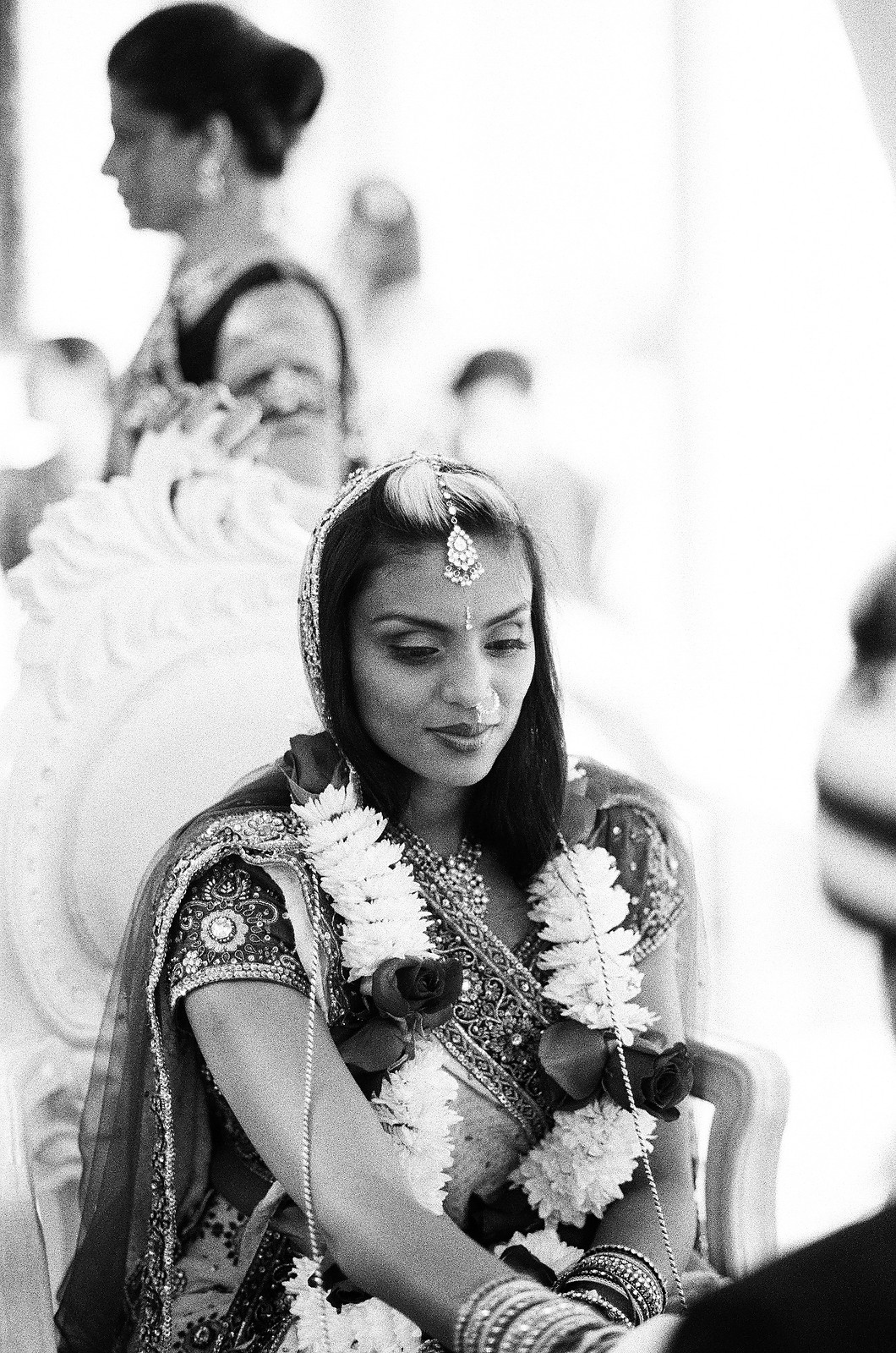 black and white photo of indian bride during wedding ceremony