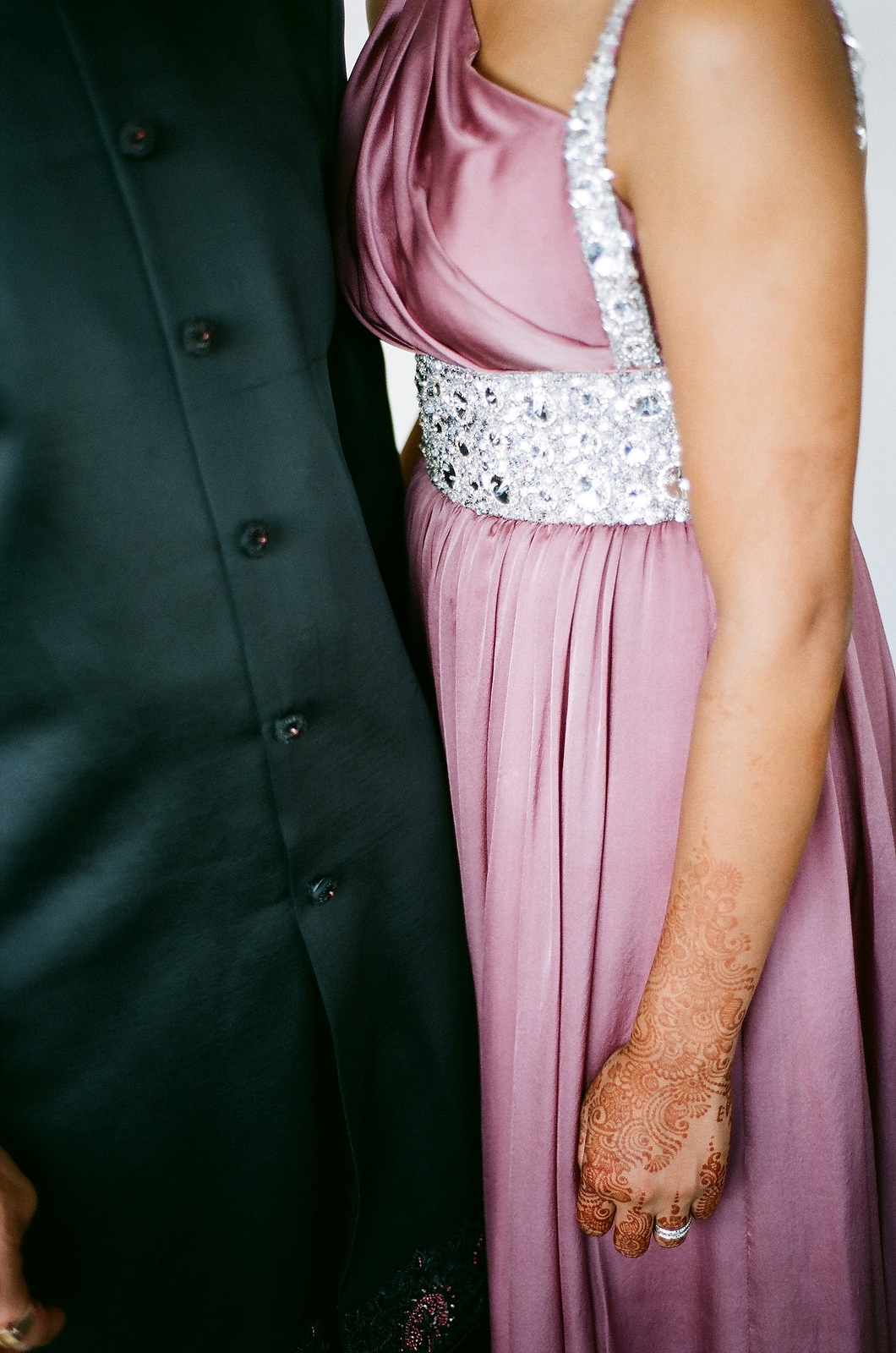 indian wedding couple in dressy outfits by wendy g